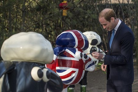 prince william painting a sheep sculpture