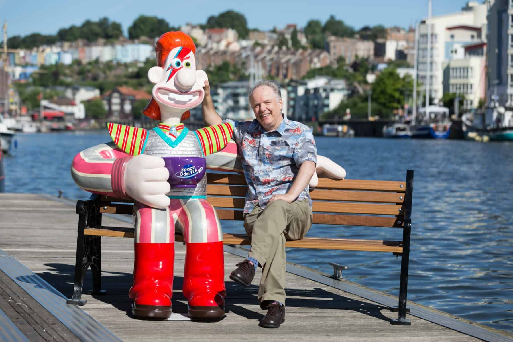 nick park sat with a wallace sculpture