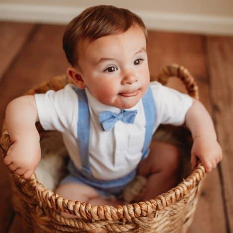 child sat in basket