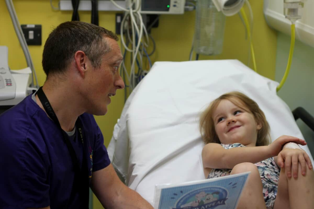 a doctor reading to a patient