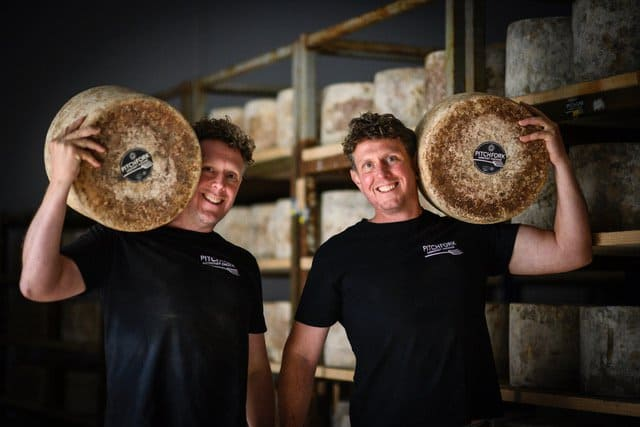 men holding cheese